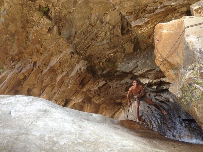 Rappelling through a waterfall in Tenaya Canyon