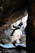 "Jonah snagging the jug at the top of ""Name Plate"" V4 in Willow Spring."