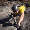 Tom Caldwell pulling through the crux moves of Smooth as Silk