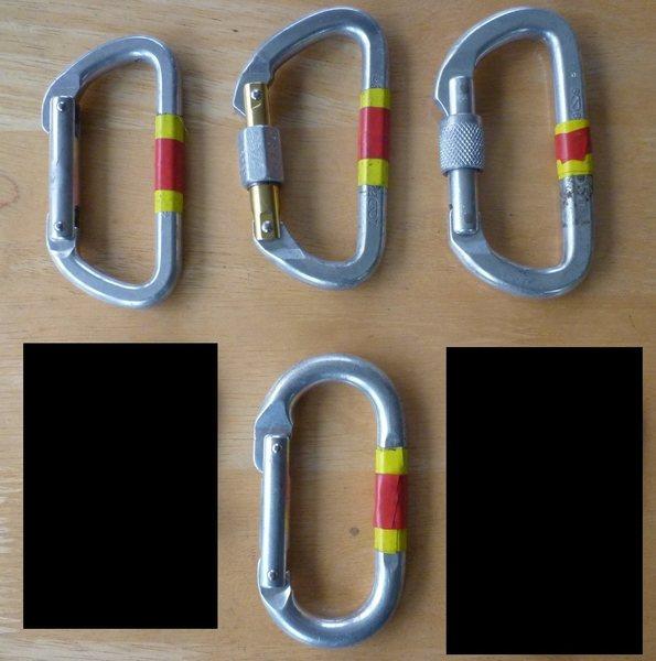 Biners.  Clockwise from bottom: oval, Light D, REI locker, Omega locker