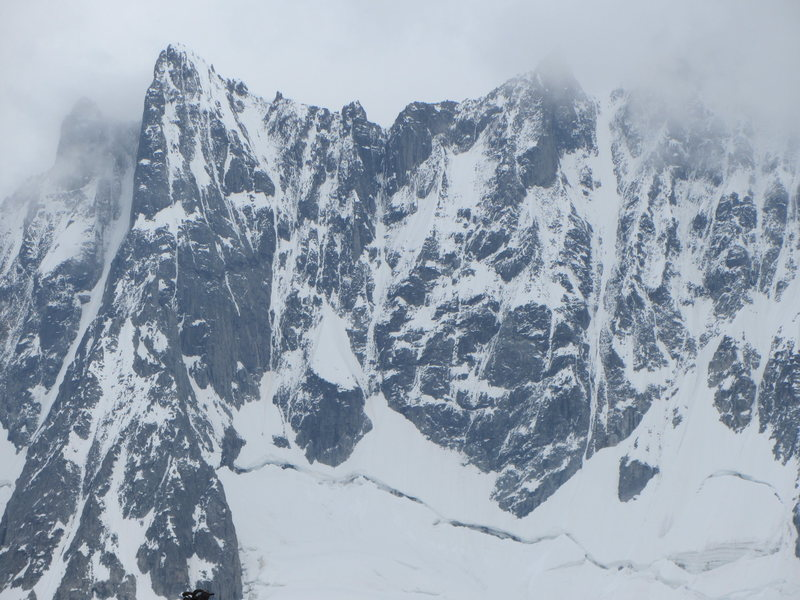 the Triolet cirque offers many ice climbing options. Pointe du Domino is the summit on the left and Aiguille de Triolet is the summit masked by clouds on the right