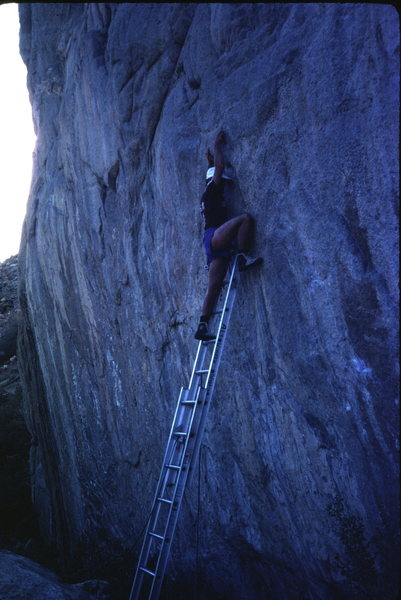 An early attempt on a difficult route at the base of the Grotto Wall.