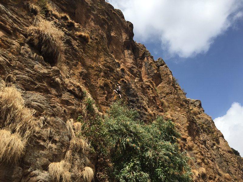 Climber on Almaz (The Diamond) belayed by UK Addis local Ciara
