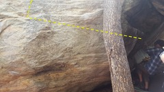 The climbing here is getting ready to start the route on the jugs inside the cave