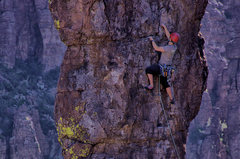 Rock Climbing Photo: Chase E. placing protection for the crux movel