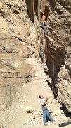 Rock Climbing Photo: standing up into the rest below the crux