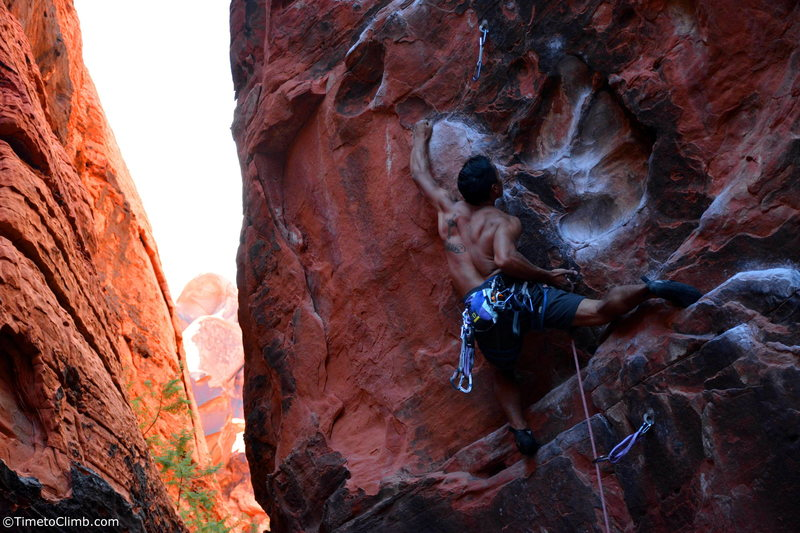 Kevin Santos pulling the rope to make the clip<br> Link - http://www.timetoclimb.com/climbing/the-black-corridor-sport-climbing-in-red-rock/