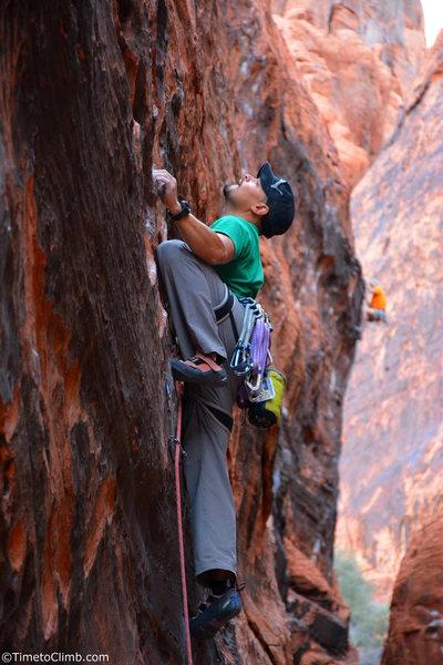 "Mel Rivera on ""Bonaire"" <br> Link - http://www.timetoclimb.com/climbing/the-black-corridor-sport-climbing-in-red-rock/"