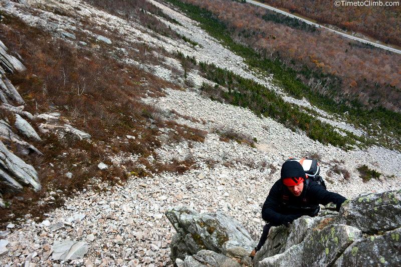 Matt Bacalakis climbing up Whitney Gilman Ridge<br>