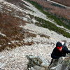 Matt Bacalakis climbing up Whitney Gilman Ridge<br>