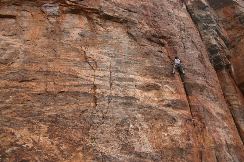 Winter fun. Erik Murdock on Precipitation 5.9 at the Weathertop. Today would be a great day to climb at this crag.