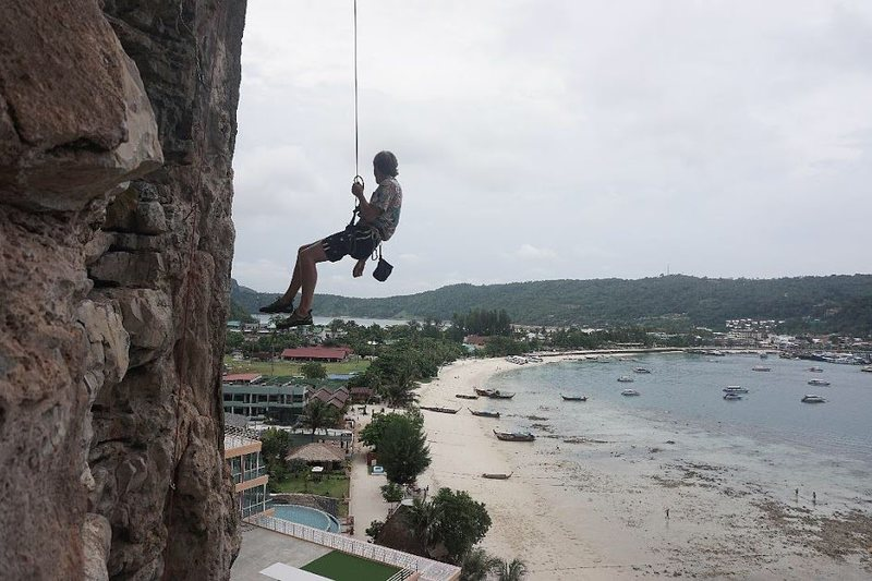 Climbing on the over crowded island of Phi Phi