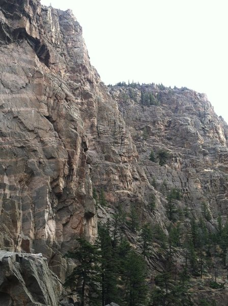 Route ascends prominent buttress in middle of photo.