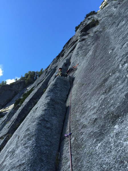 Kyle chillin on a sweet belay ledge! One of the middle pitches where you're no longer climbing slab.