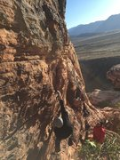 Rock Climbing Photo: Luc heel-hooking the first move.