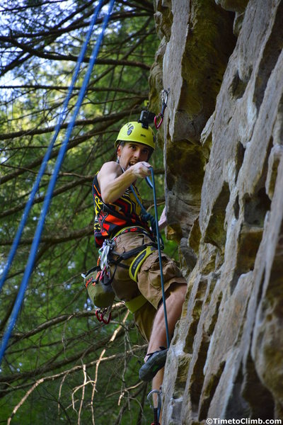 Zach Adamczyk going for the clip while climbing Getting Lucky in Kentucky in Red River Gorge