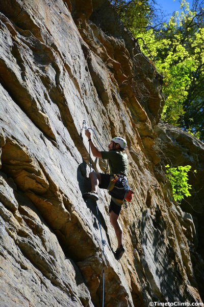 "Nicholas Hernandez clipping in the rope while climbing ""Return of the Manimal"" in the Muir Valley section of Red River Gorge"