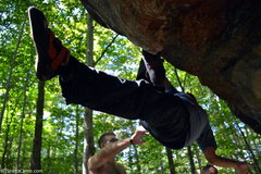Rock Climbing Photo: Mel Rivera hanging, foot flagged while bouldering ...
