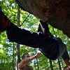 """Mel Rivera hanging, foot flagged while bouldering """"Ice Cold"""" a V7 traverse at Nine Corners Lake in the Adirondacks of NY. <br> Read More - http://www.timetoclimb.com/bouldering/boulderingintheadirondacks/"""