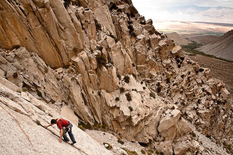 John Fisher moving just left of his namesake climb.