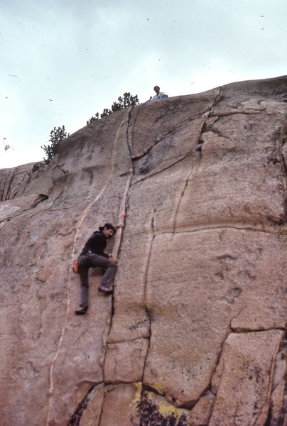 "Marc Hill follows Dave Caunt up ""Squealer"" (5.10b thin) in 1990"
