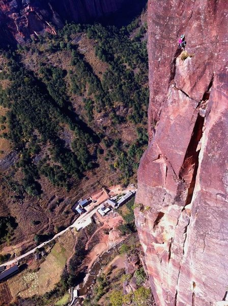 Juanna high on back to the primitive. 11- traverse pitch. Shot from the dawn chimney