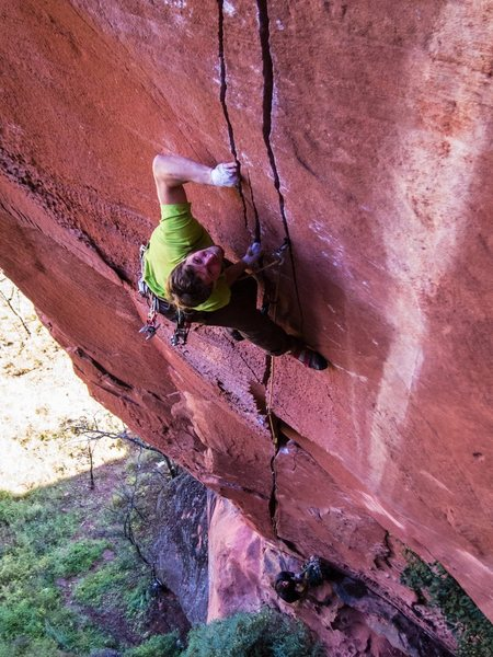 Alex at the p2 crux.  Photo by Brandon Gottung