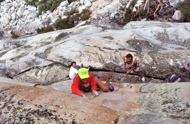 "Dave Yerian leading ""Sweet Suspicion"" (5.11a), while Marc Hill belays and Dave Caunt looks on."