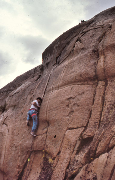 "Dave Caunt leading ""Squealer"" (5.10b) before the thunderstorm began. August, 1990."