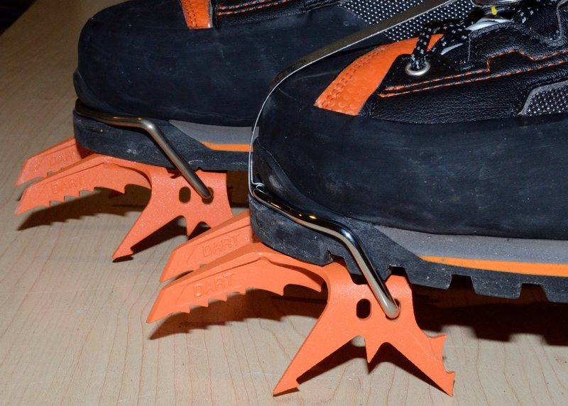 The front boot in this picture has the BD bail and the back boot has the std Petzl bail.