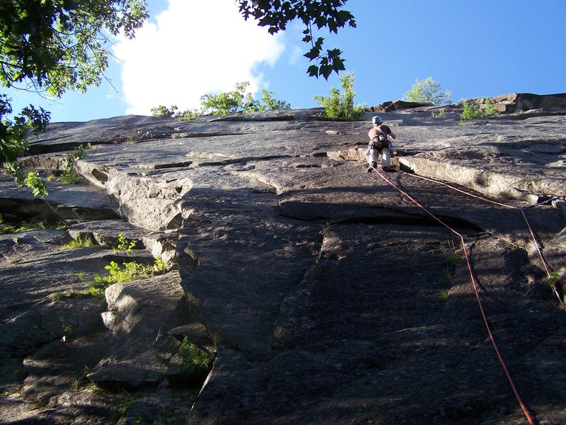 In the foreshortened crack/corner, looking ahead to the crux slab on pitch 1.