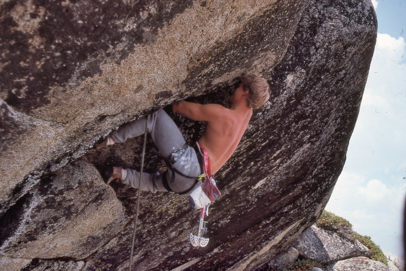 """Elliott Robinson on the first lead ascent of """"Back Breaker Roof"""" (5.11d OW) in 1988."""