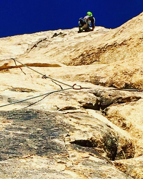 Heading up the steep crack section to the gear belay just below the Dappled Mare crossover--ignoring the tempting but inadvisable retro-anchor at the midpoint of the pitch.