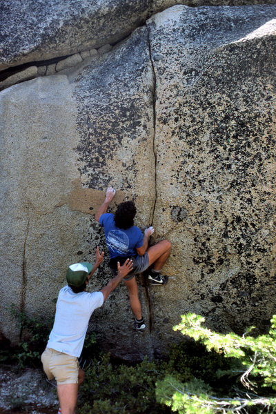 The late Billy Blitzo starting to boulder the 5.11d finger crack on the left-hand side of the Back Breaker Cliff.