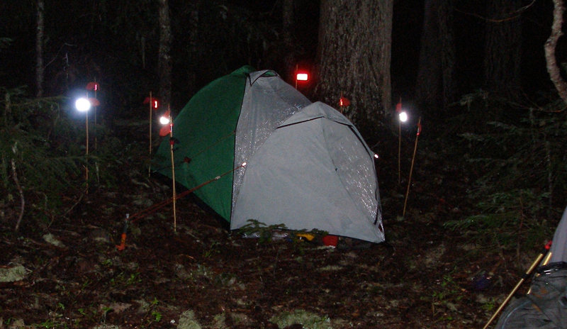 Photo nor as dorky as it looks...maybe dorky, but was<br> wand experiment below Rainier Cleaver route, 2001.  Red/white rectangular flagging at rear of tent is the flag to focus on.  The white is too bright to look at and that's the point: perfect for all seasons travel.  Note: wands used for other things, i.e., marking tent tension lines, stakes, etc.  Mere presence prevents tripping in the dark.