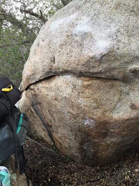 View of the boulder and problem as you veer off the trail.
