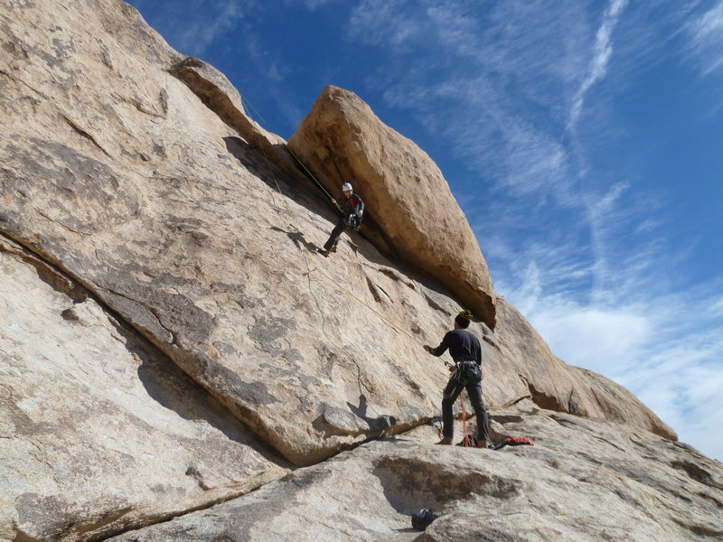 Lowering off the draws after leading, great warm up route for the 5.10's near by.