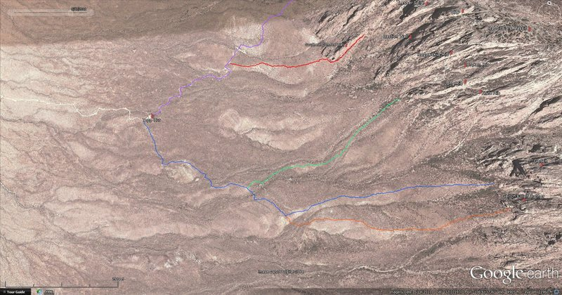 The blue line marks the normal Gertch trail, and the green line marks the Rib Cage detour. The point at which the Rib Cage trail departs the Gertch trail is marked by a large rock cairn amidst a limestone outcrop just east a low hill. Also shown here are the trail leading to Gertch's Half Brother (orange), the trail leading into Rabbit Ears Canyon (purple), and the trail leading up to Southern Comfort Wall (red).