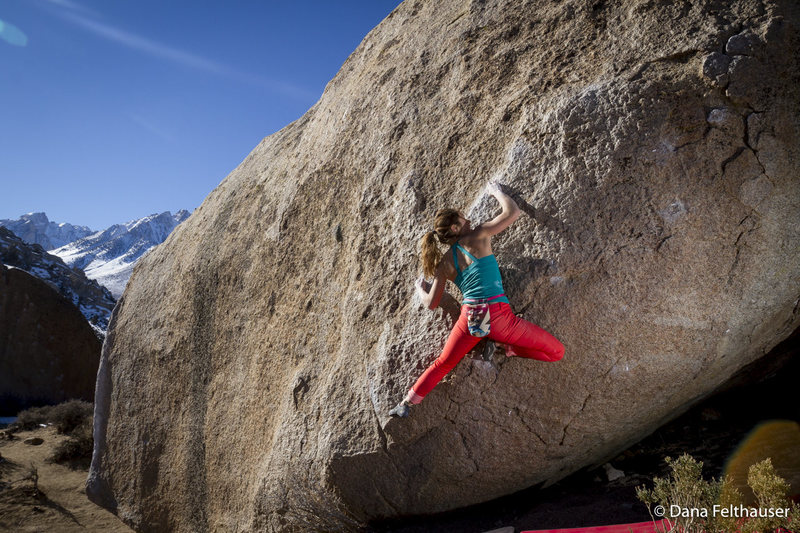 Hannah Hall works the moves on Devoted Traverse v5 in the Buttermilks.<br> <br> Photo by www.danafelthauser.com<br> Instagram: @danafelthauser<br>