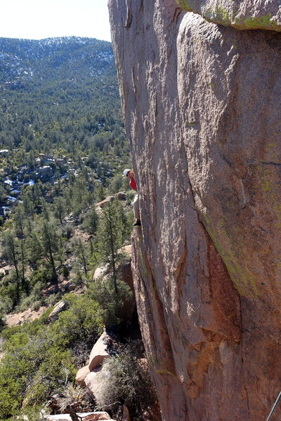Joe Garcia on the pedestal above the thin crack. The wide crack is visible below him.