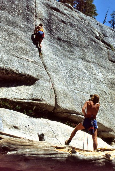 "Couple practicing lead climbing on the popular ""Puppy Crack"" (5.6) in 1988"