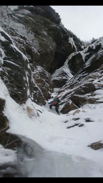 """This is either a stiff """"approach"""" or a long and snowy first pitch. Either way there are some awkward fifth class moves getting to the bolted belay."""