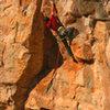 Cruising the crux boulder problem<br> Claim Jumper (5.12)