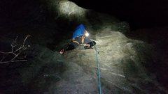 Placing the #1 ball nut to protect the lower crux.