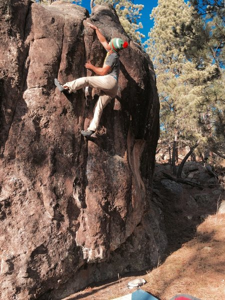 Luke Kretchmar trying to commit to the start of the crux.