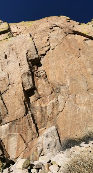 The impressive south wall of the upper middle section of Broken Rib, as viewed from just above the chockstone shown in one of the photos.