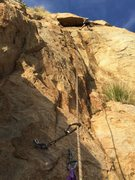 Rock Climbing Photo: Traverse right and up the roof (crux) of pitch 3, ...