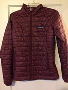 Women's XS nano puff. Synthetic primaloft insulation. Like new, worn a few times. Color is dark currant. It looks identical to the nano puff below it except the stitching on this one is the same color as the jacket and the inside is red.