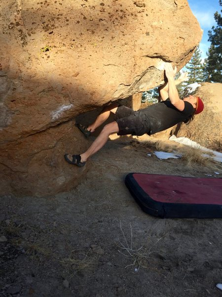 Stretching out to reach up to the big jug on Toe Jam, V2+