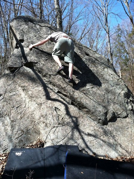 James climbing the slab.  Photo by Kris Kearney.